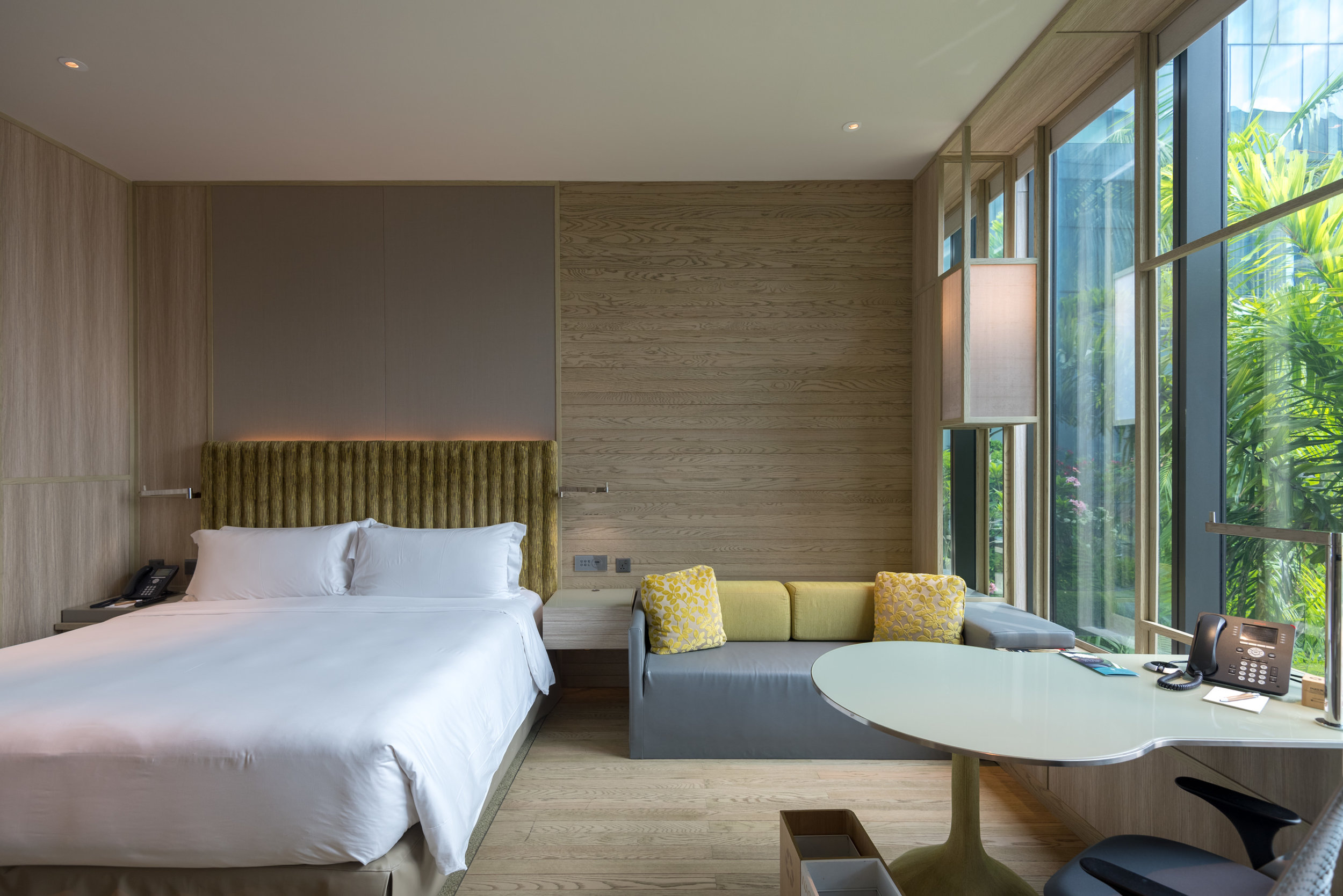 Bedroom with Seating Area  Orchid Club Deluxe Room - PARKROYAL on Pickering