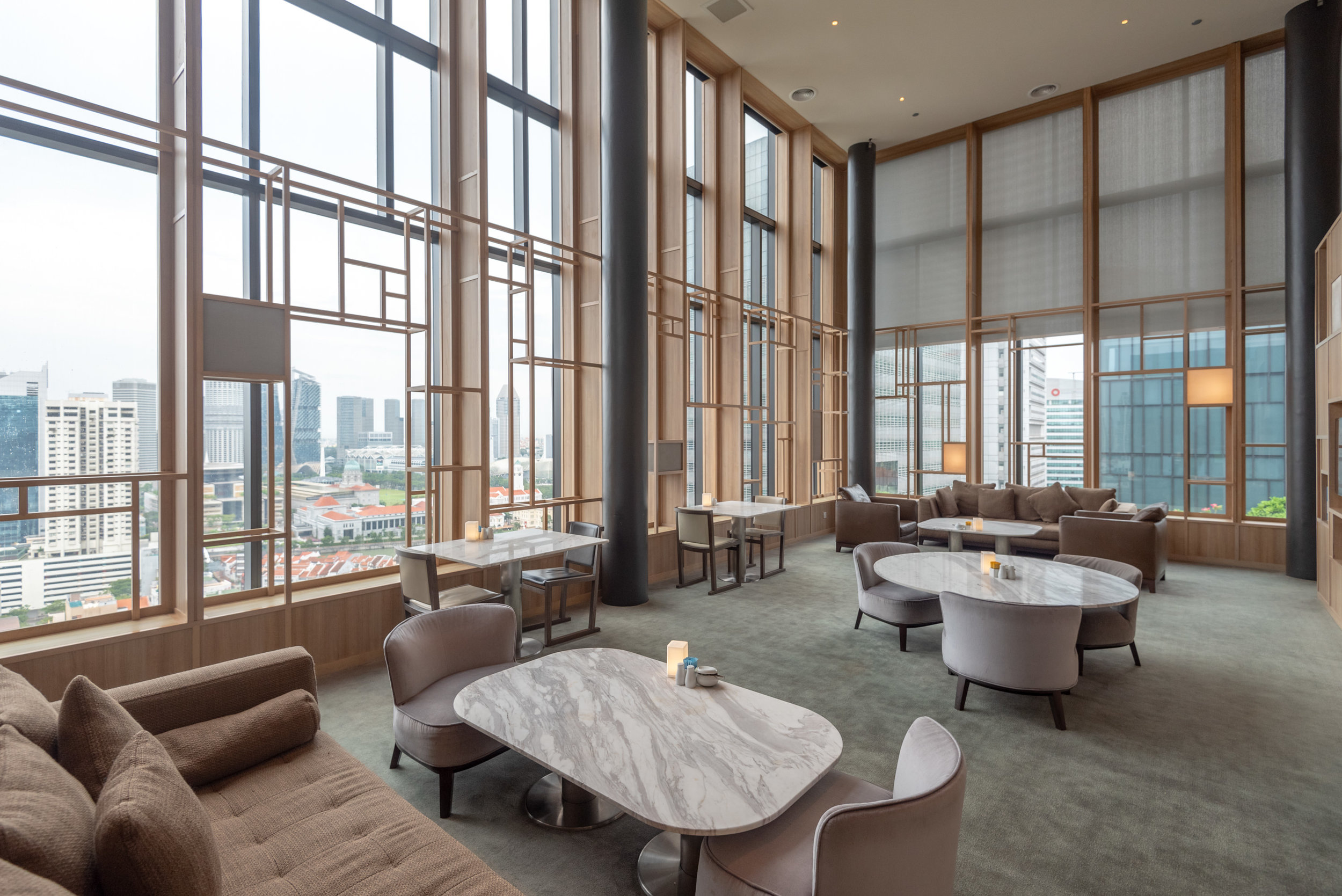 Seating Area by the Window  Orchid Club Lounge - PARKROYAL on Pickering