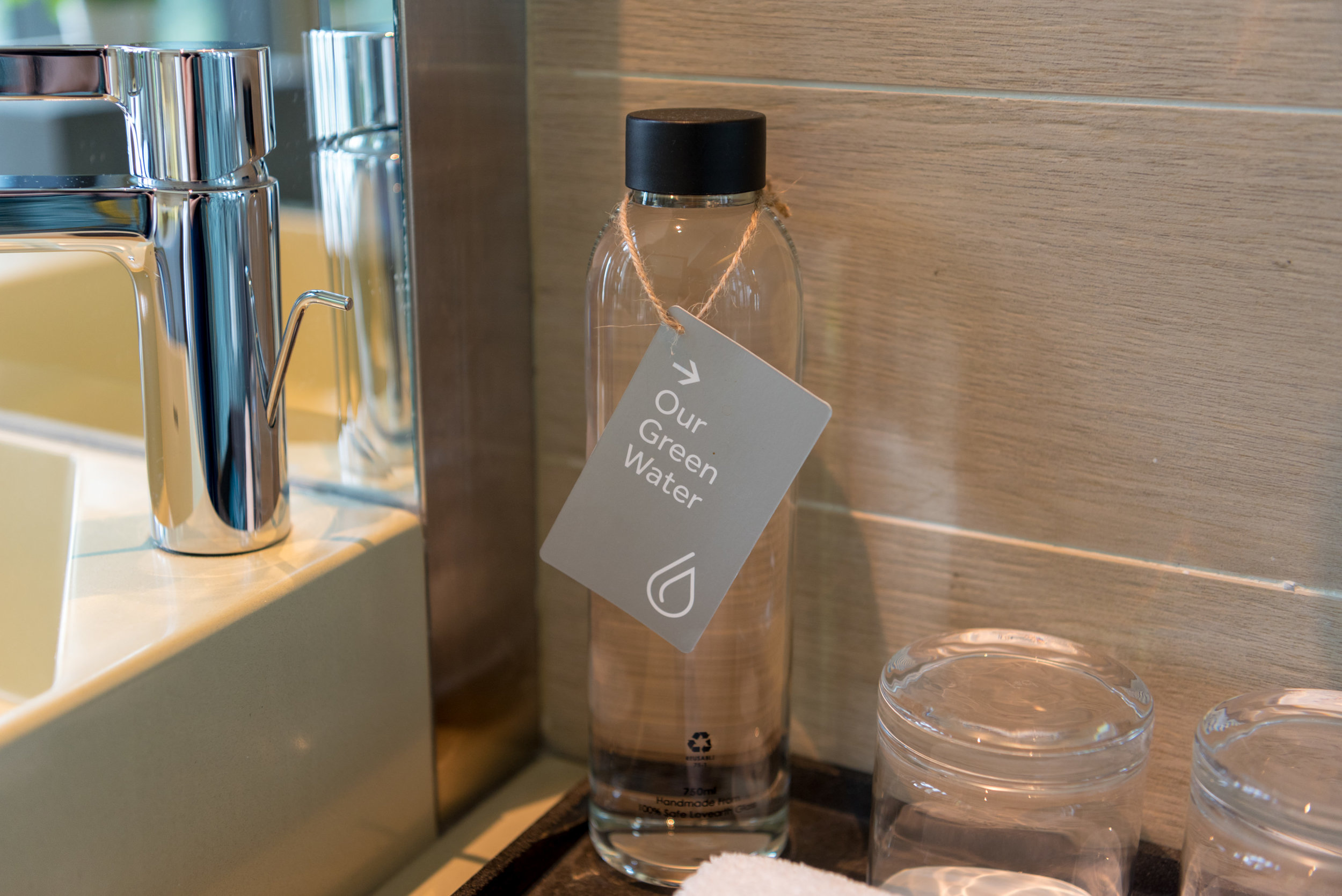 Water provided in Glass Bottles  Orchid Club Deluxe Room - PARKROYAL on Pickering