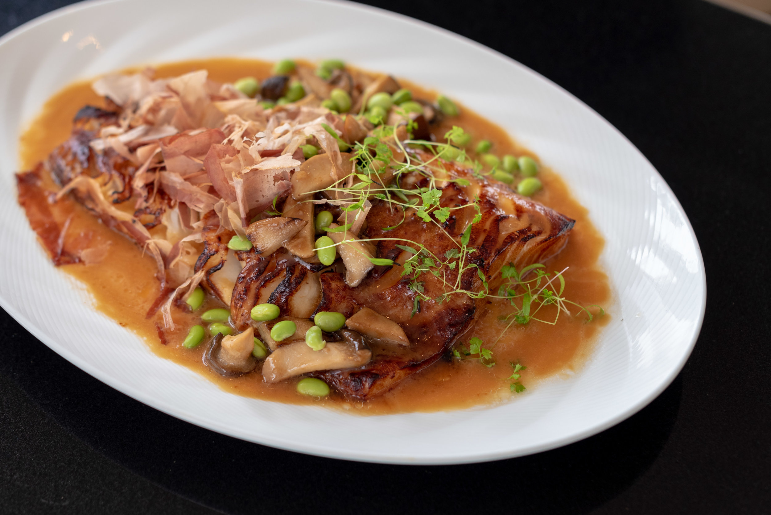 Caramelised Black Cod Fillet with Soy Glaze Edamame and Bonito Flakes  Racines - Sofitel Singapore City Centre