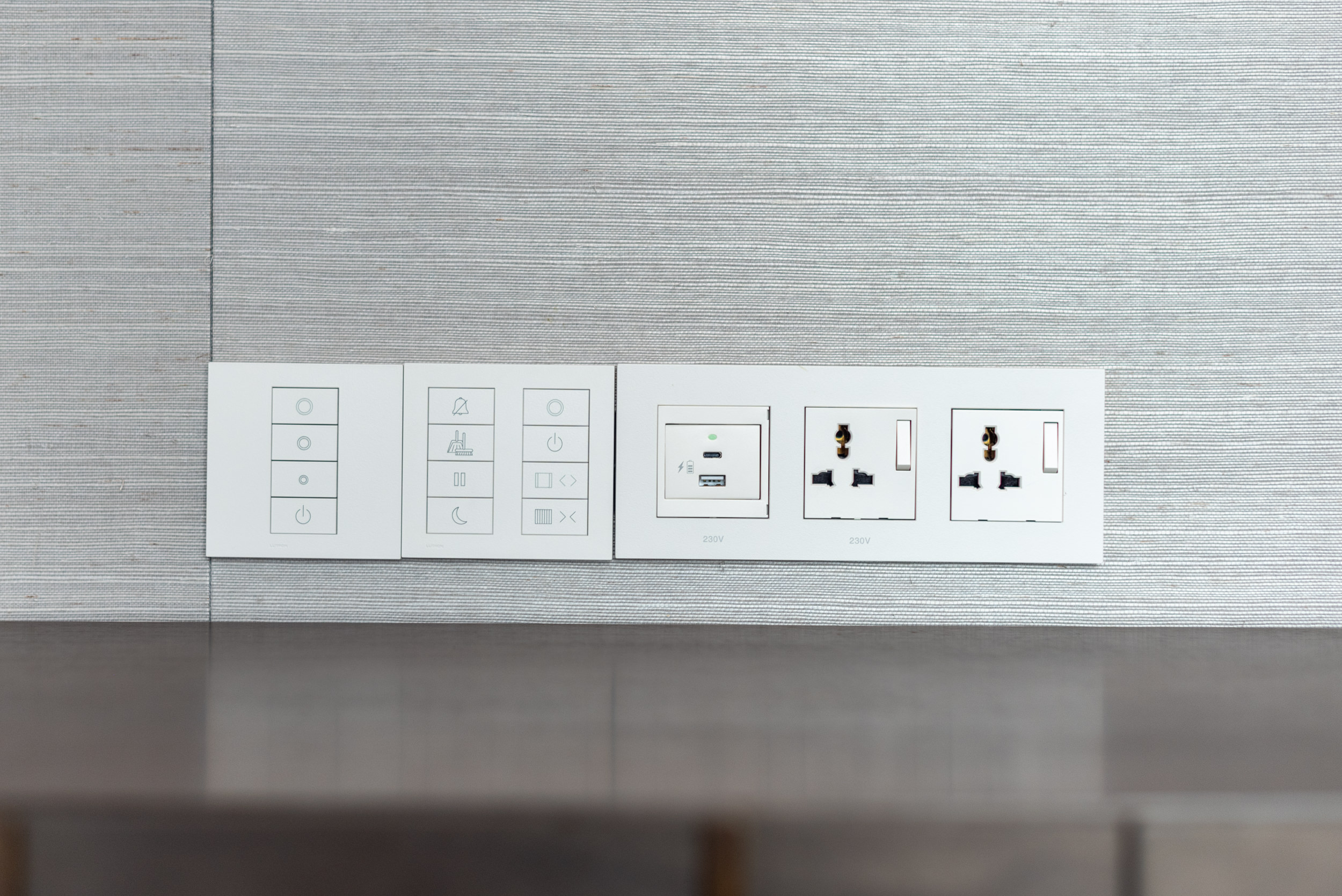 Bedside Controls and Power Outlets  Ambassador One-Bedroom Suite - Four Seasons Hotel Singapore