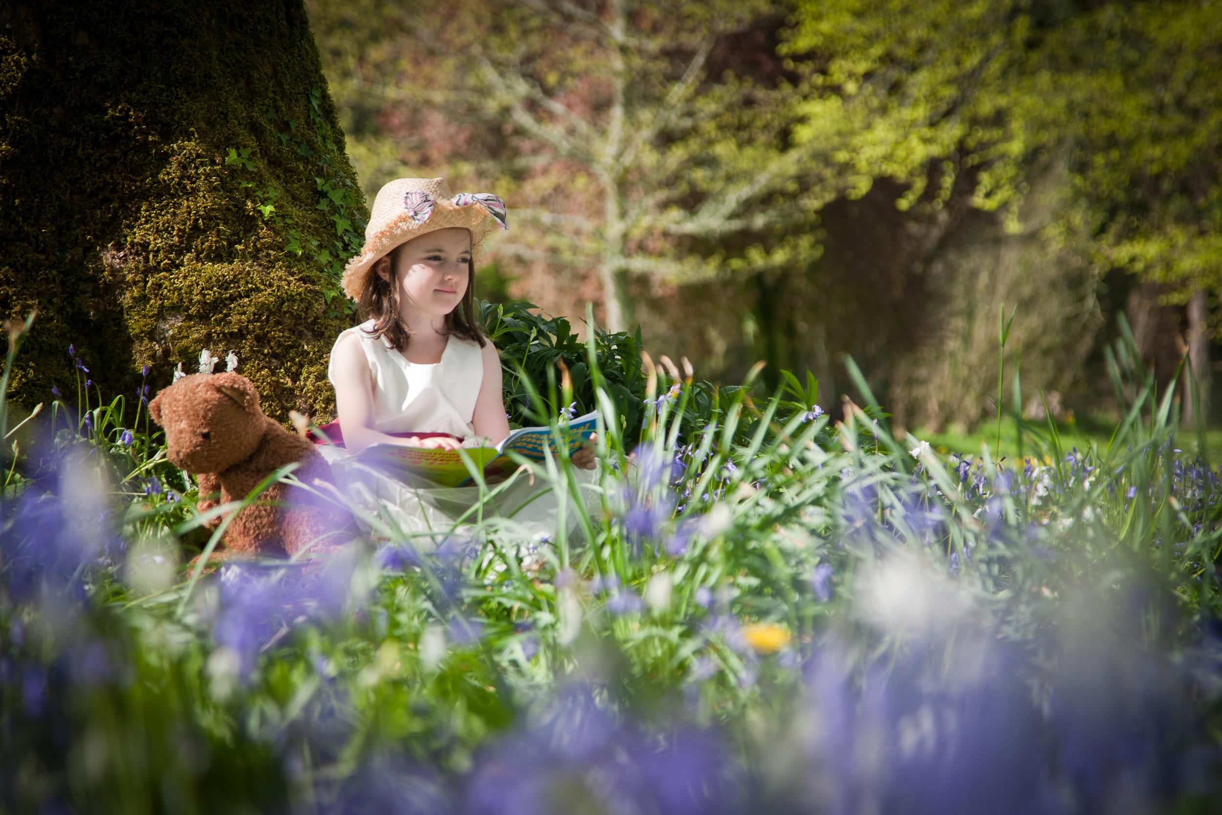 beautiful girl in a field of bluebells