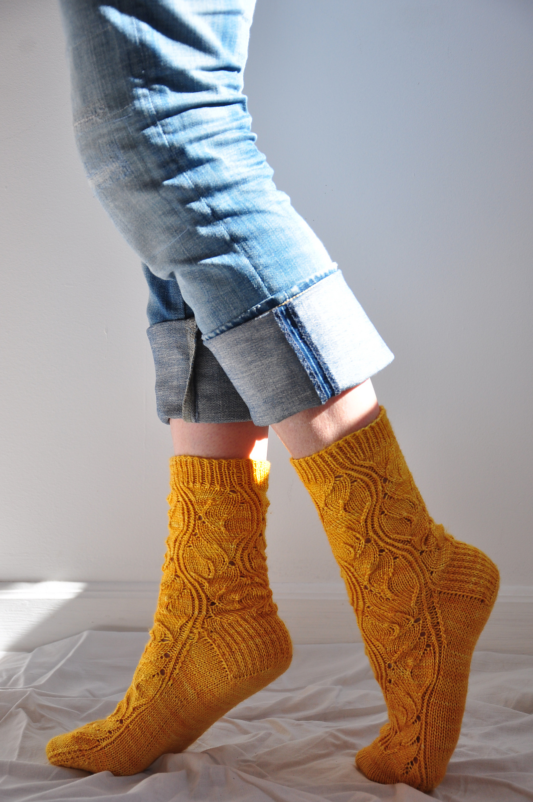 For those who are concerned about orange too close to their face, I have a perfect sock pattern. Rumpelstiltskin by verybusymonkey. Image courtesy of anneleterme.