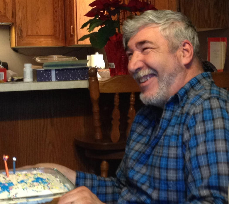 He looks pretty happy about that cake - the truth is that someone put a trick candle on it for him.