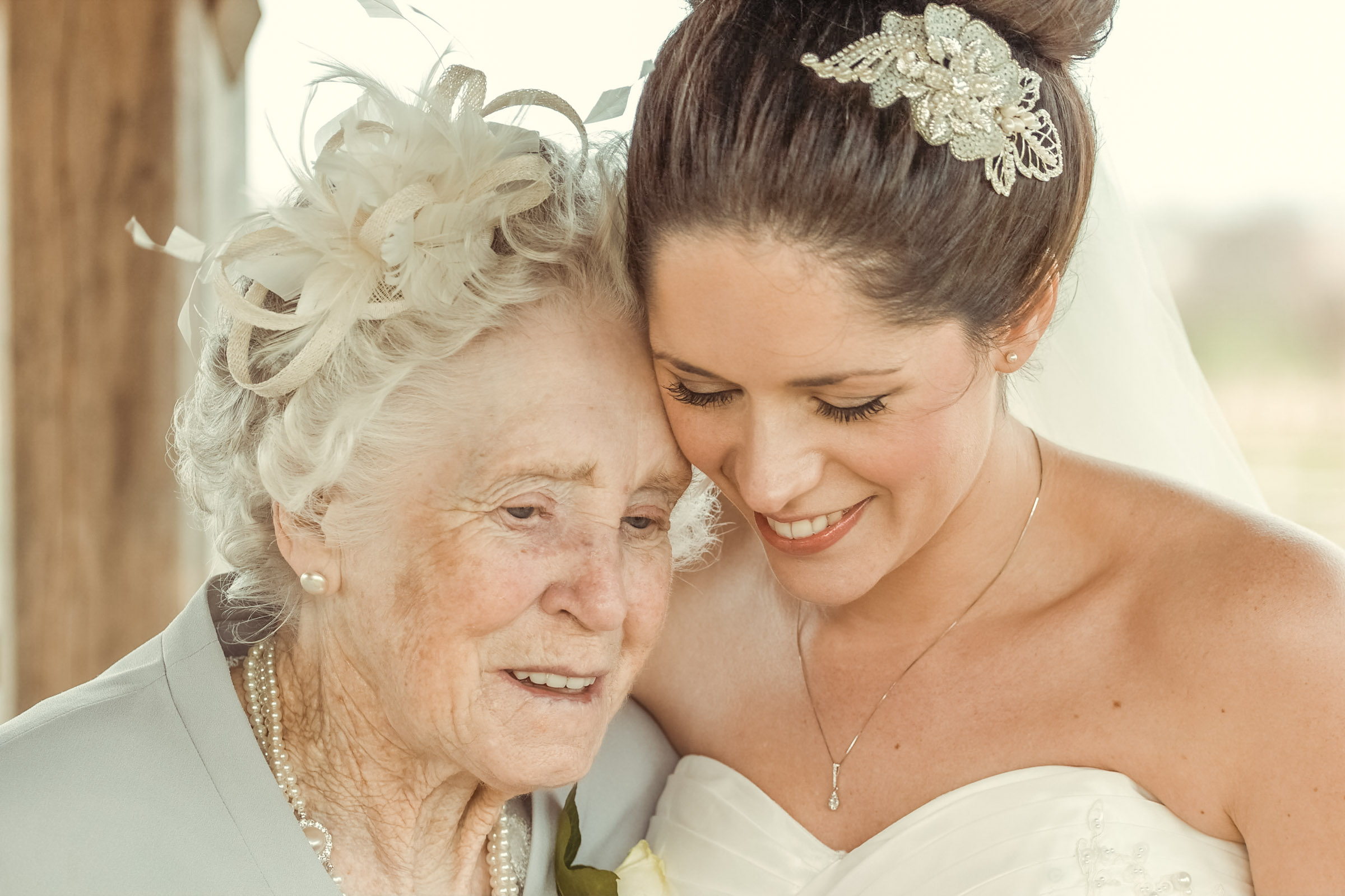 A photograph of Mel and her Grandmother sharing a moment at Mel and Toms Wedding taken at Mythe Barn,