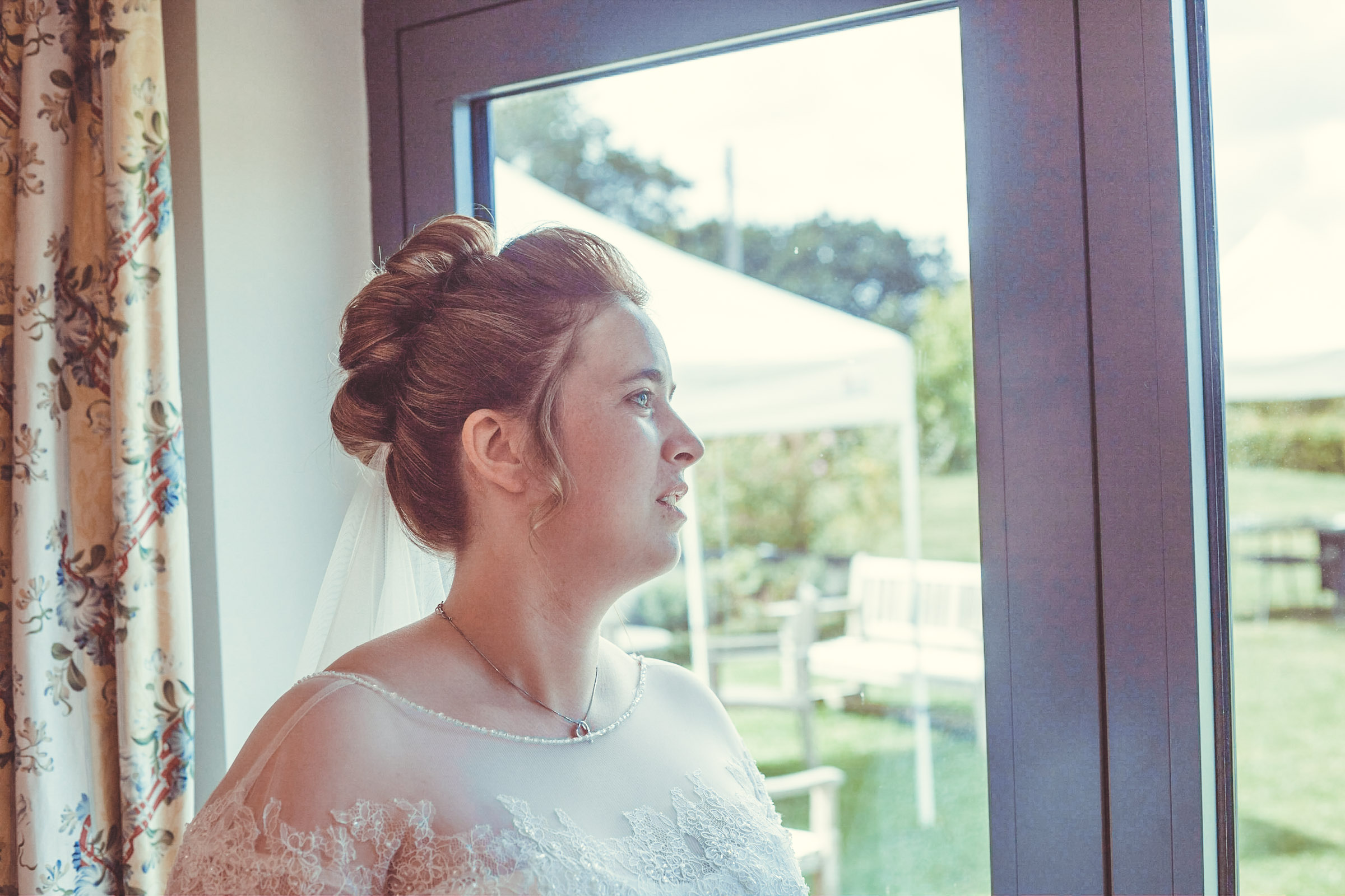 Natalie Heron looking out of the window on her wedding day.