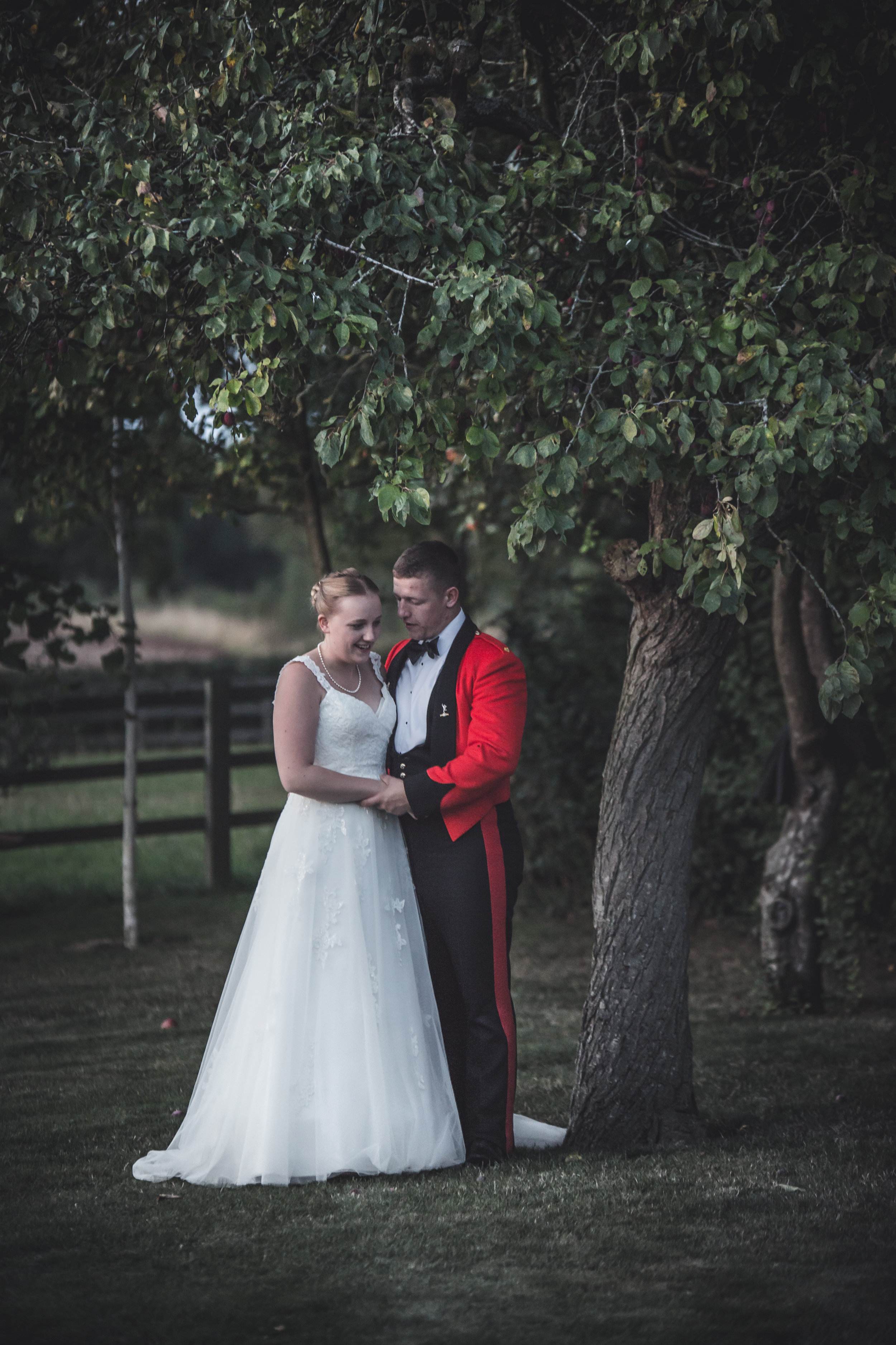 Aimee and Andy share a moment together outside Manor Hill House, Andy is wearing his formal military suit, and Aimee is wearing a white wedding dress.