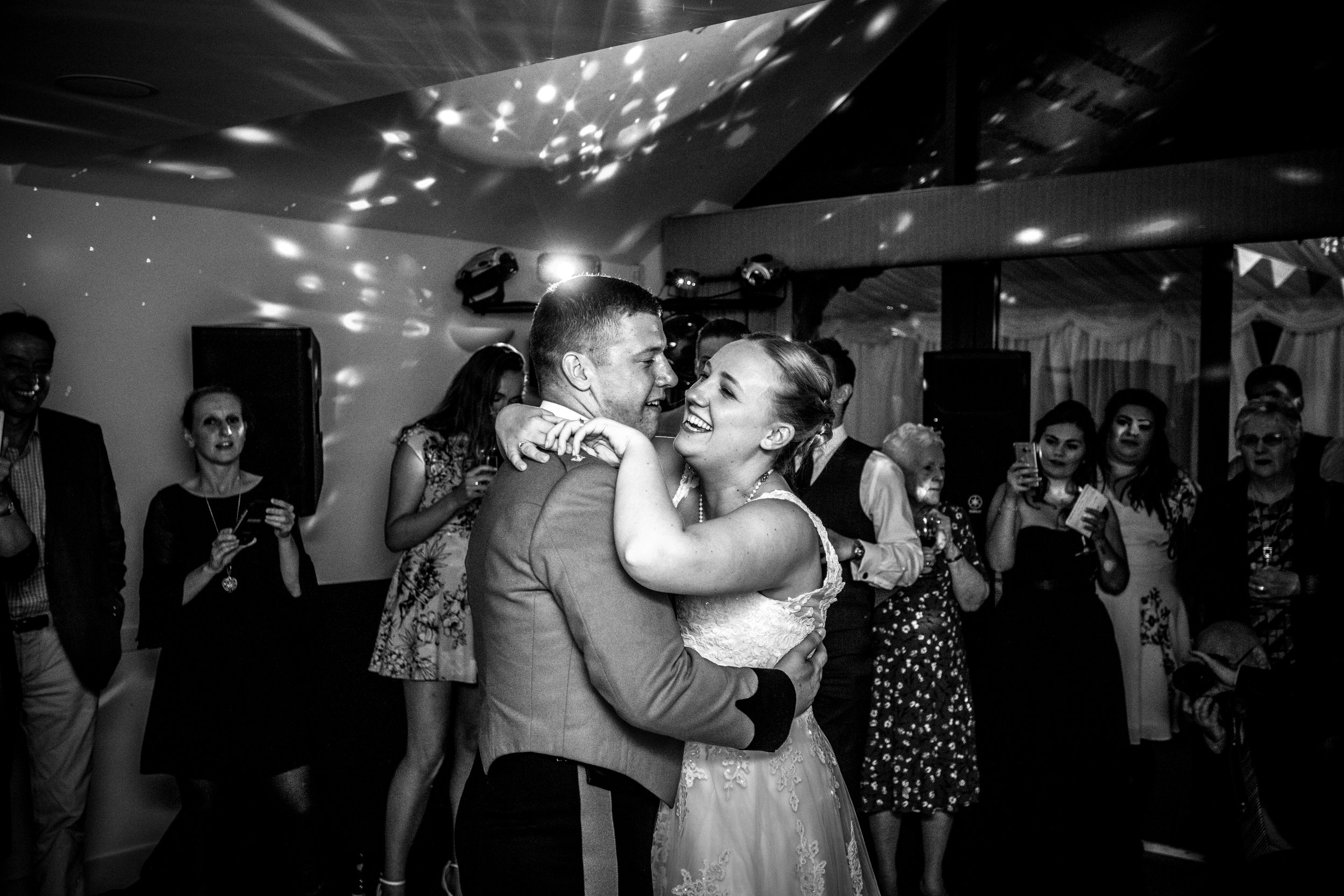 Aimee and Andy have their first dance, they had a military wedding, the photograph is in black and white, this photograph was taken at Manor Hill House near Bromsgrove.