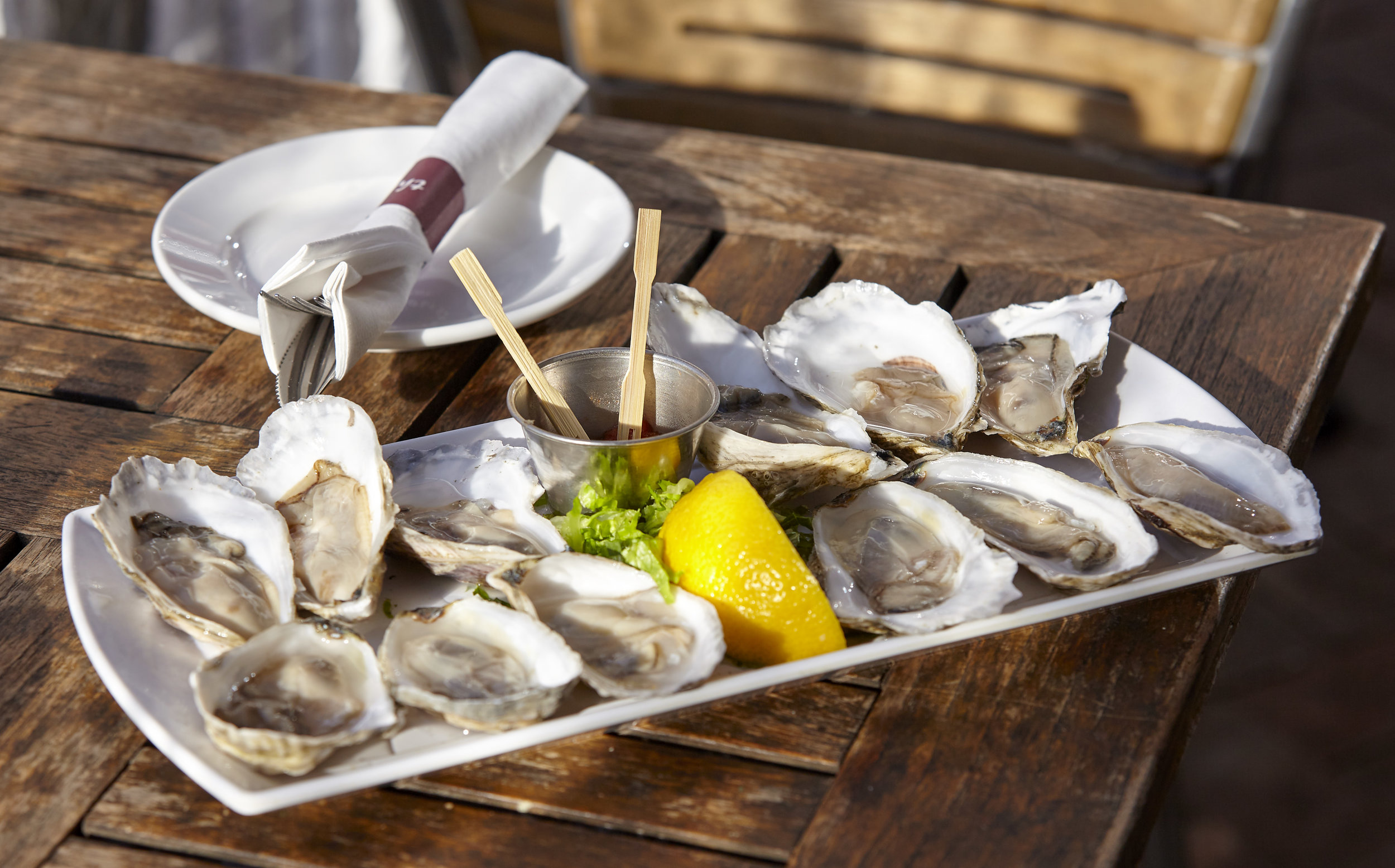 the red house features 2 for $1 oysters everyday ( minimum of 6 ) from noon - 5pm & 9 pm - close. Everyone's first dozen oysters are priced at 2 for $1; after that oysters are just $1 each -- still a great deal!    Between 5 pm - 9 pm , oysters are still only $1 each. The origin of our oysters will be subject to change.  Sorry, reservations are not accepted for oysters & drinks tables.