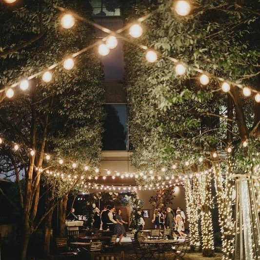 Something about being beneath the lights in our gardens makes us have all the good feels. 🍃