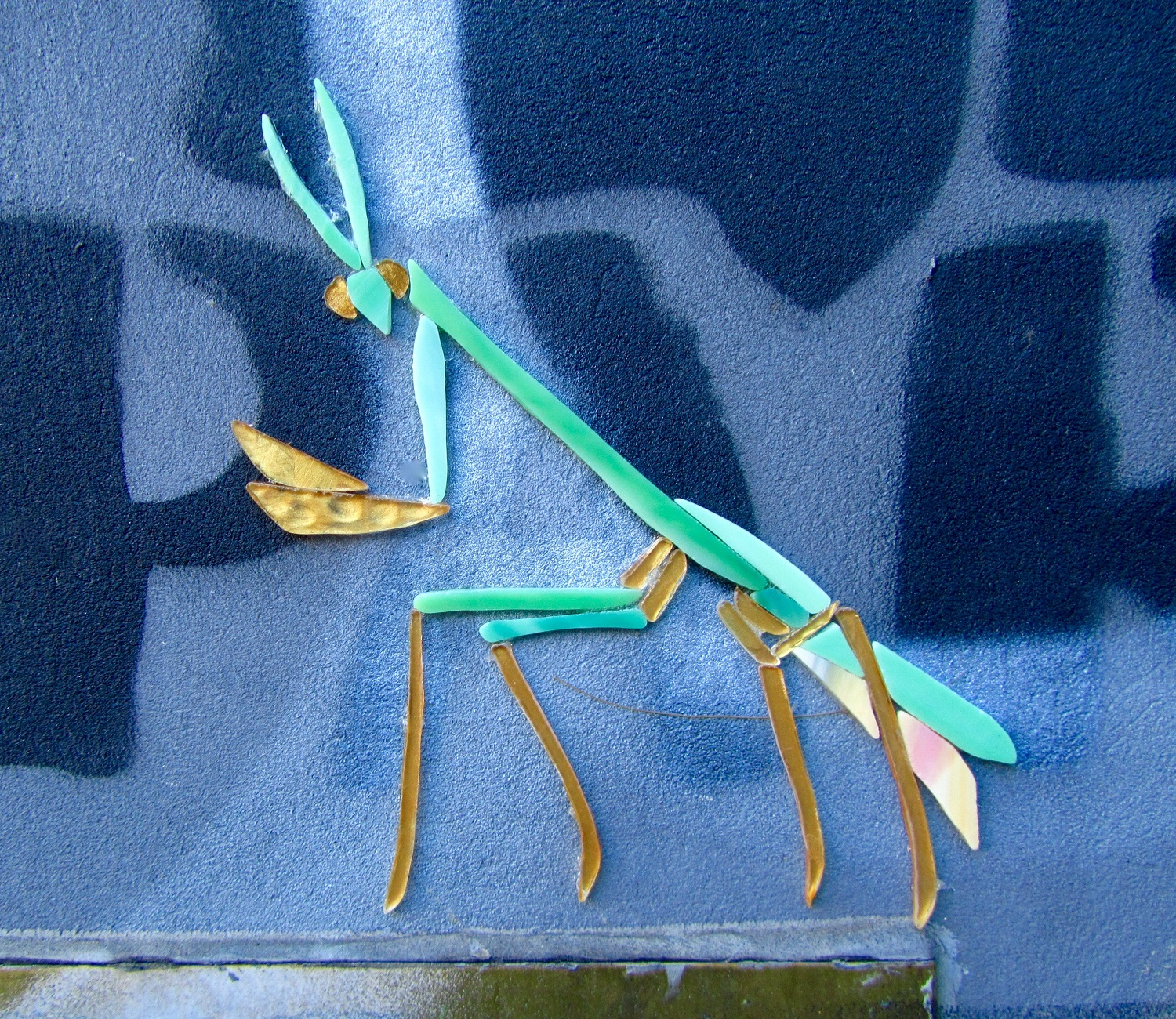 Wing-glass-street-art-praying-mantis.jpg