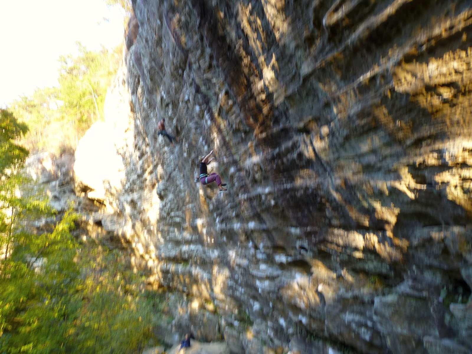 "Naomi taking the plummet off the classic ""Chainsaw Massacre"", 5.12 at The Red River Gorge"