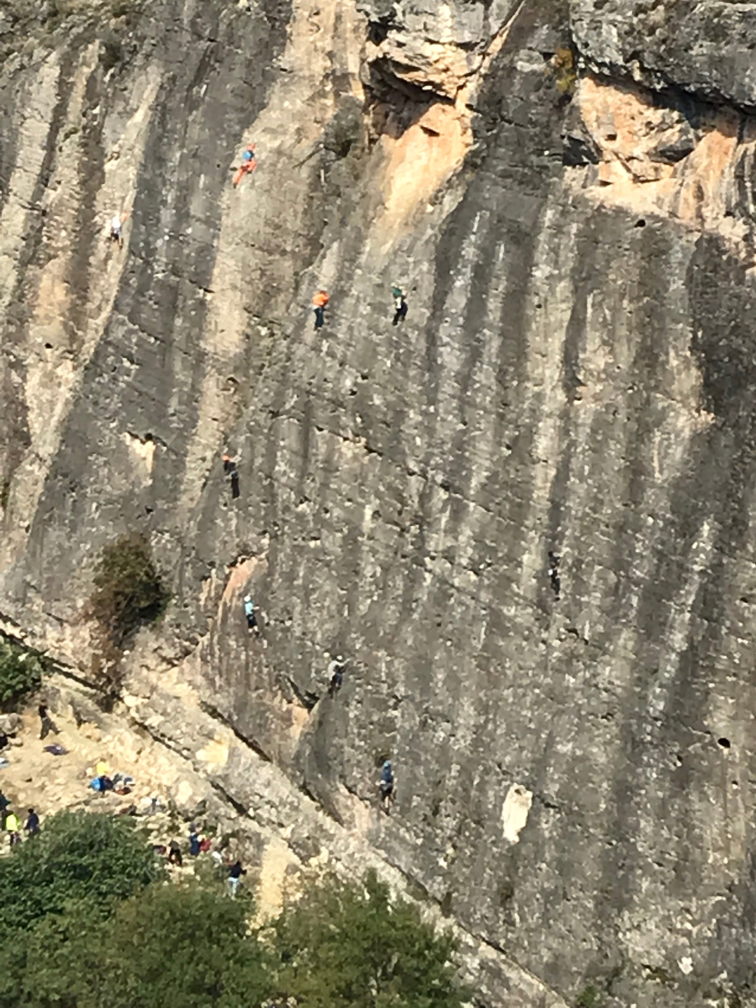 zoomed perspective on number of climbers at the crag