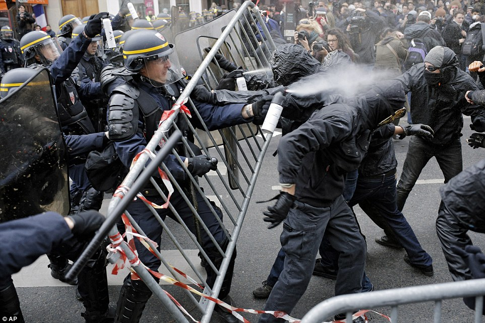 2EE7FA9800000578-3338255-Hitting_back_One_riot_police_officer_sprays_a_large_amount_of_sp-a-46_1448820978371.jpg