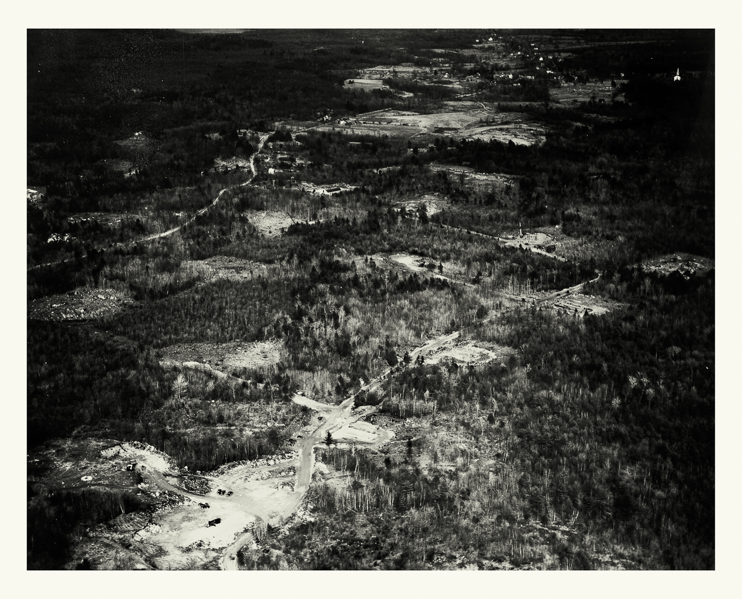 """Photograph No. PC 433. """"Aerial photograph depicting the construction progress on East Group 20 Hi-X Magazines, with Beechwood in the distance. Bunkers located at the Naval Ammunition Depot at Hingham, MA.' March 8, 1942; Records of Naval Districts and Shore Establishments, RG 181, NARA Boston."""