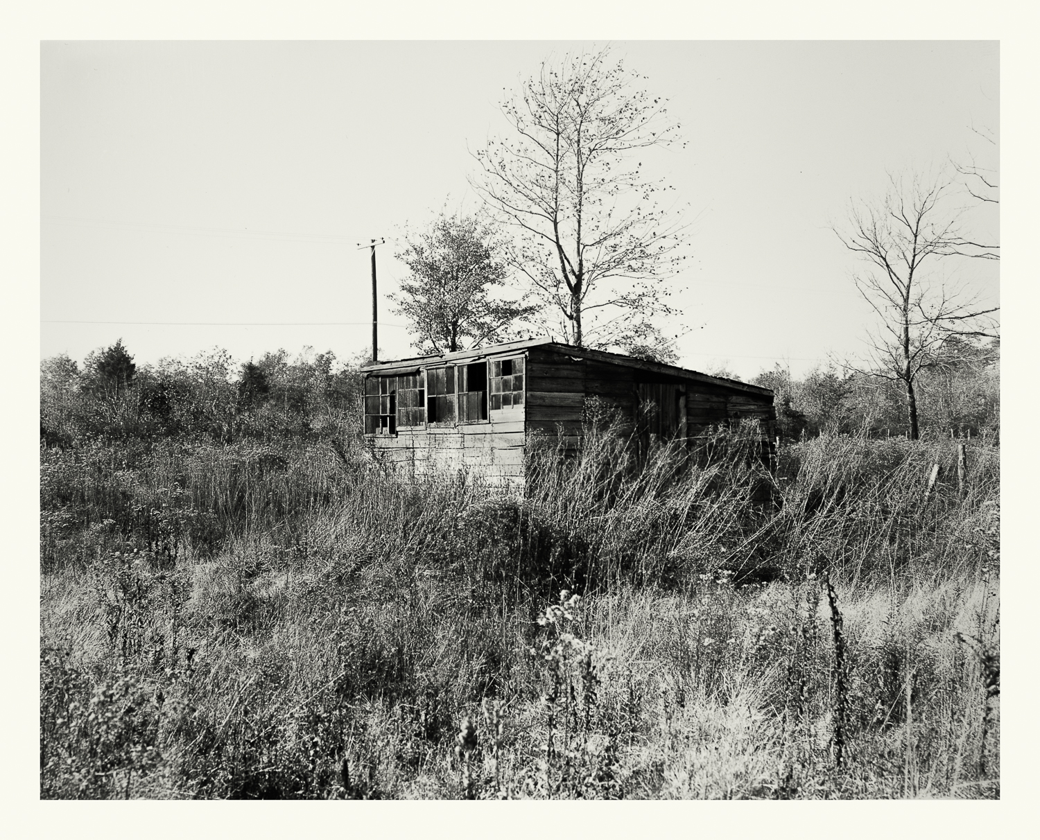 """Photograph No. PC 411. """"Photograph surveying shacks and shanties that were vacated and subsequently removed prior to the construction of the Cohasset Naval Ammunition Depot Annex."""" c. 1930; Records of Naval Districts and Shore Establishments, RG 181, NARA Boston."""