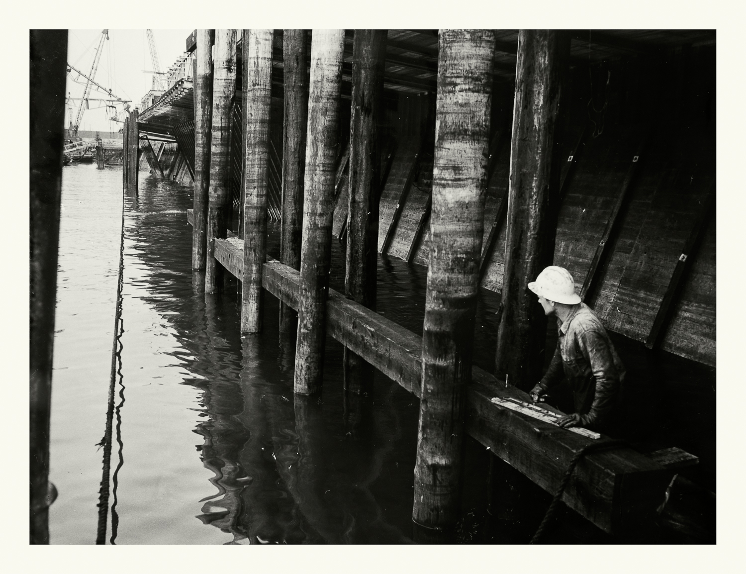 """Photograph No.188. """"Photograph of construction worker under the Boston Army Base Docks."""" N.D.; US Army Corps of Engineers. Records of the Office of the Chief of Engineers, 1789-1999, RG 77; NARA Boston."""