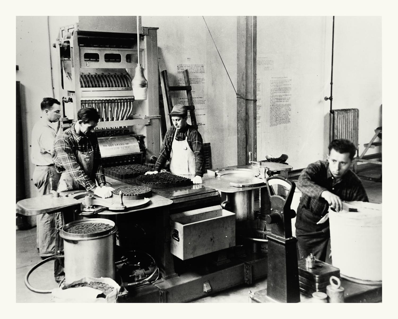 "Photograph No. PD 141. ""Photograph depicting workers assembling 16"" powder stacks for ammunition, at the Hingham Naval Ammunition Depot."" c., 1940 Records of Naval Districts and Shore Establishments, RG 181, NARA Boston."