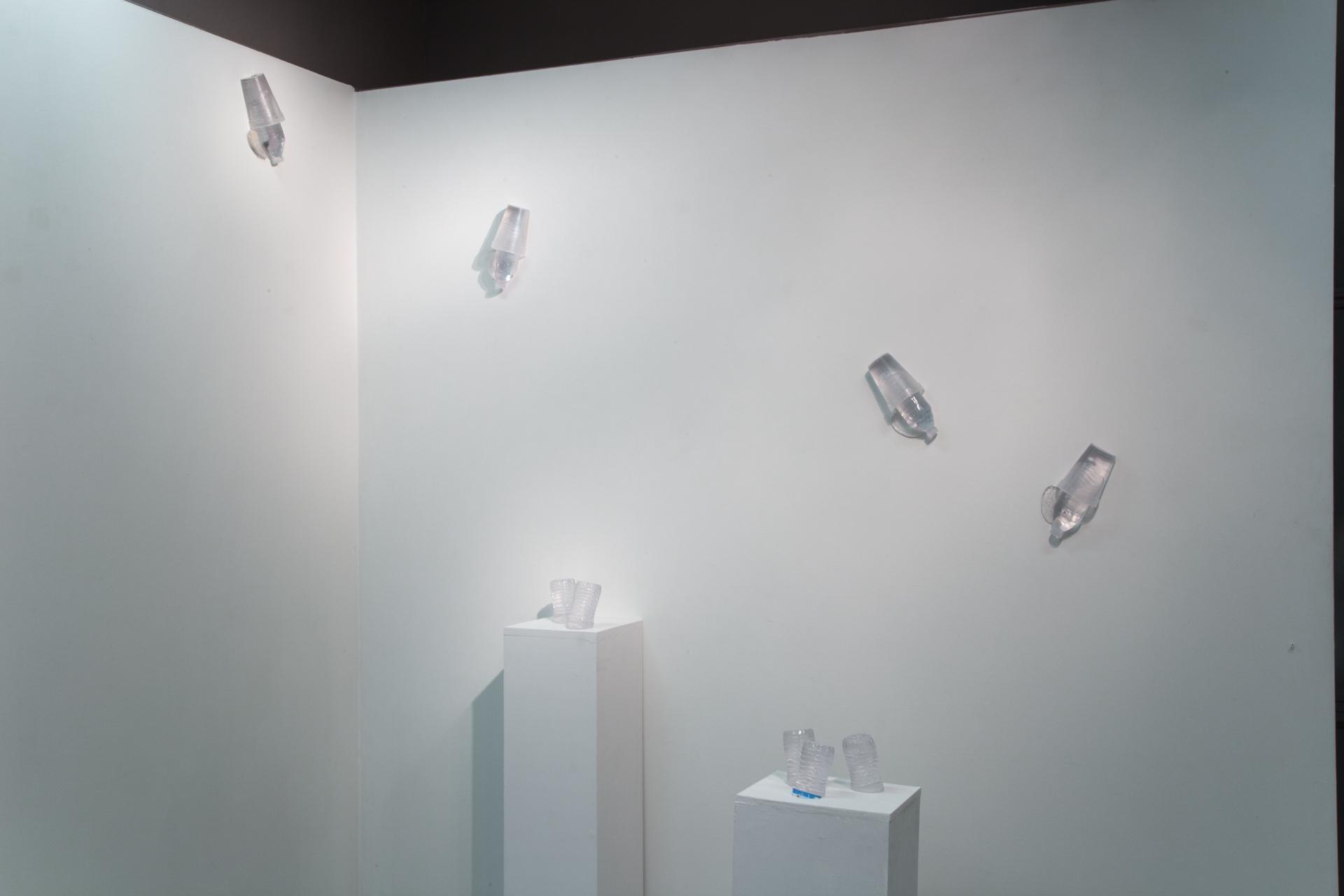 """Spill (wall pieces) and Halves Full (on pedestals)"" Gianna Stewart"