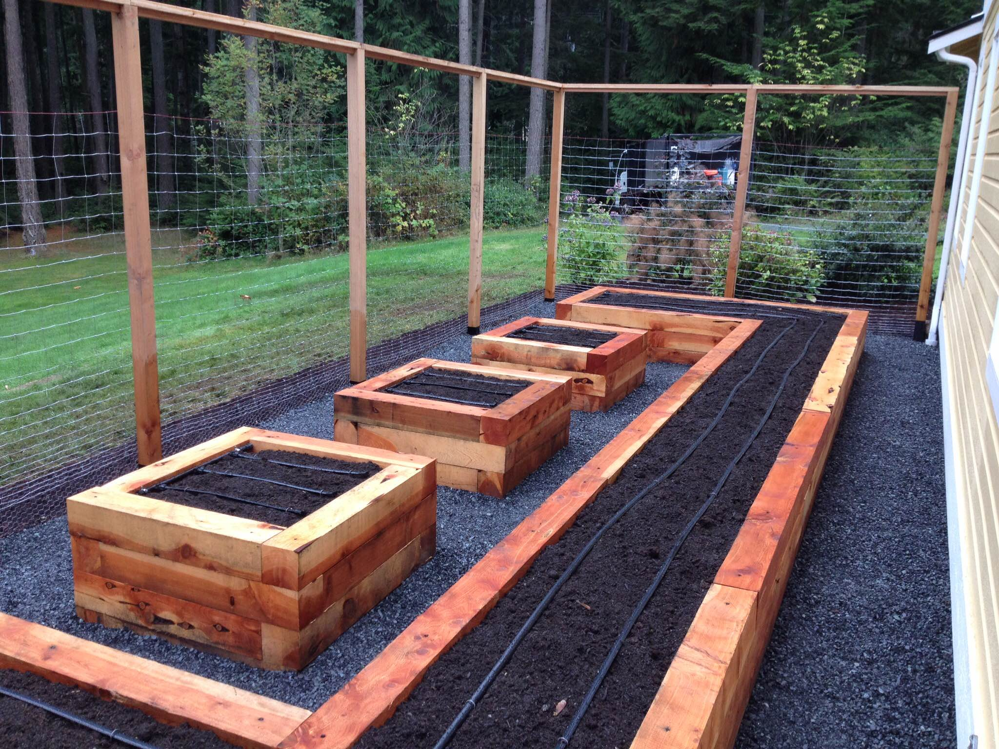 Enclosed Raised Bed Garden — Seattle Urban Farm Company on raised water garden, raised long garden, raised deck garden, raised kitchen garden, raised brick garden, raised patio garden, vertical herb garden, raised home garden,