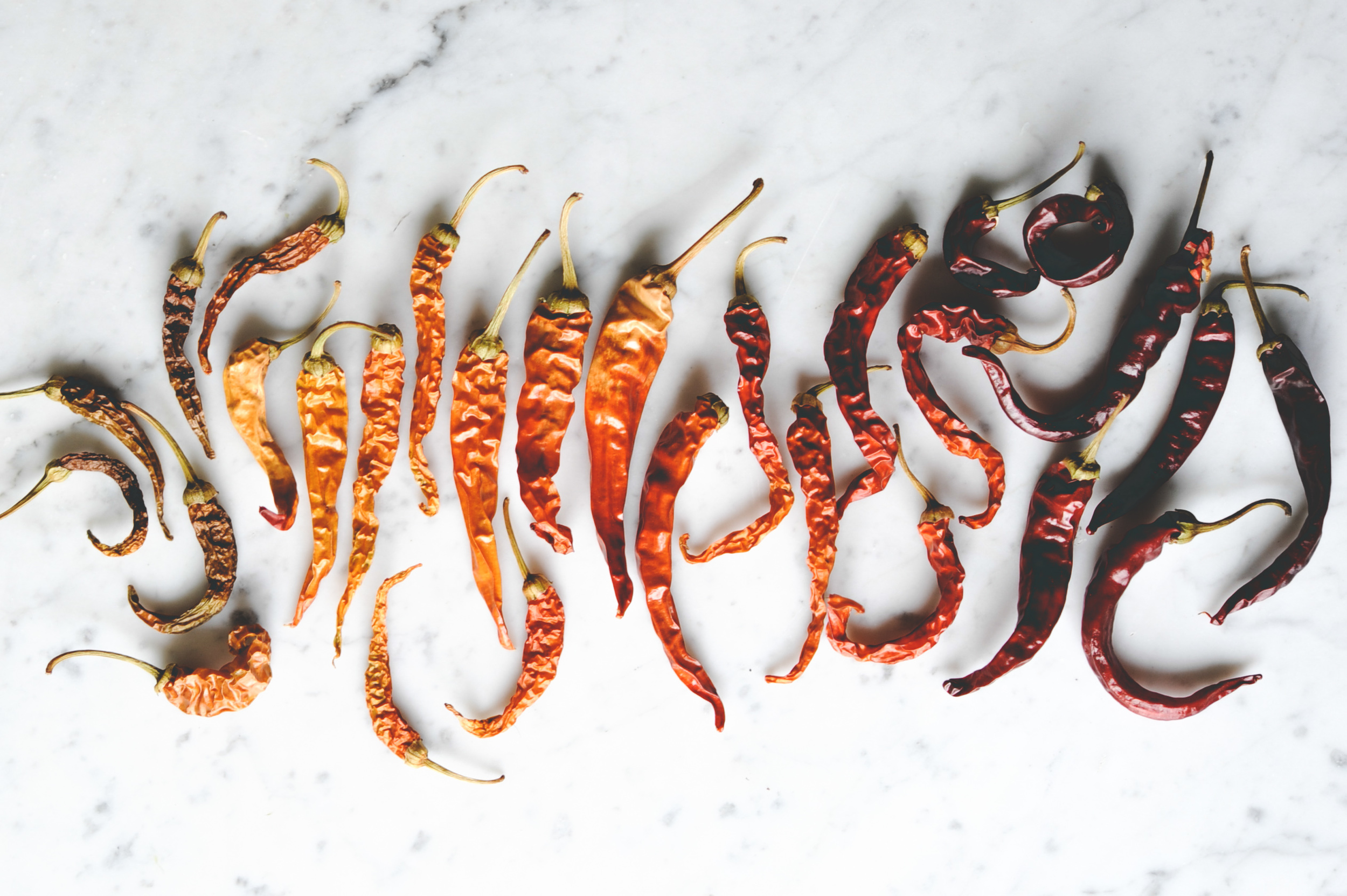 Dried Cayenne peppers - Cayenne's picked green will mature to red while drying.