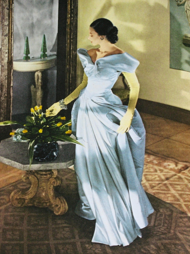 """Charles James   borrowed this gown back from his client and gave it to use in this 1948  """"Modess Because""""  ad campaign. Many of his gowns were featured by the  Johnson & Johnson's  1948-1970s series that used high-fashion as a show stopper, but seldom was he able to finish his commissioned gowns for the ads on time - often pinning them on the model."""