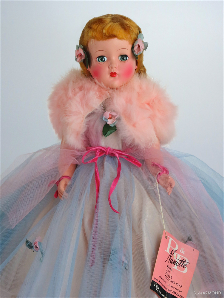 The dolls Saran hair is proudly noted with instructions inside the hang tag on how to set the wig using sugar water.
