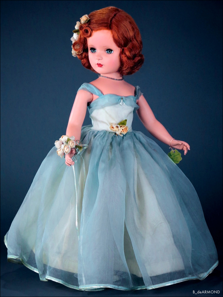 "Available in a number of pastel colors and sizes, Princess Margaret Rose 1950, 21"" early hard plastic in a blue organdy gown by the Alexander Doll Company. The doll features very soft pink accents of roses with metallic silver used in the gown, rose bouquet, beaded necklace and her shoes."