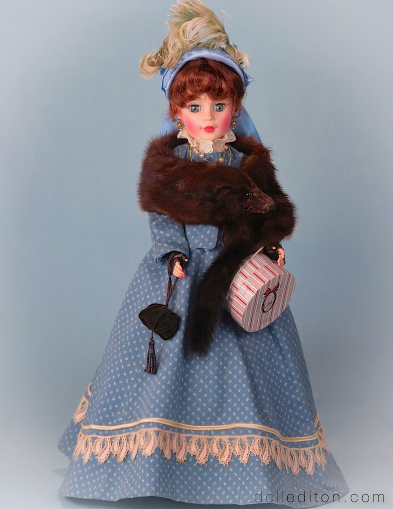 Our Victorian Lady, arrives at tea from an afternoon of shopping. Plumed hat, fur, lace gloves, hatbox and reticule purse are some of the detailing of the ensemble supplied by the author to complete the experience.