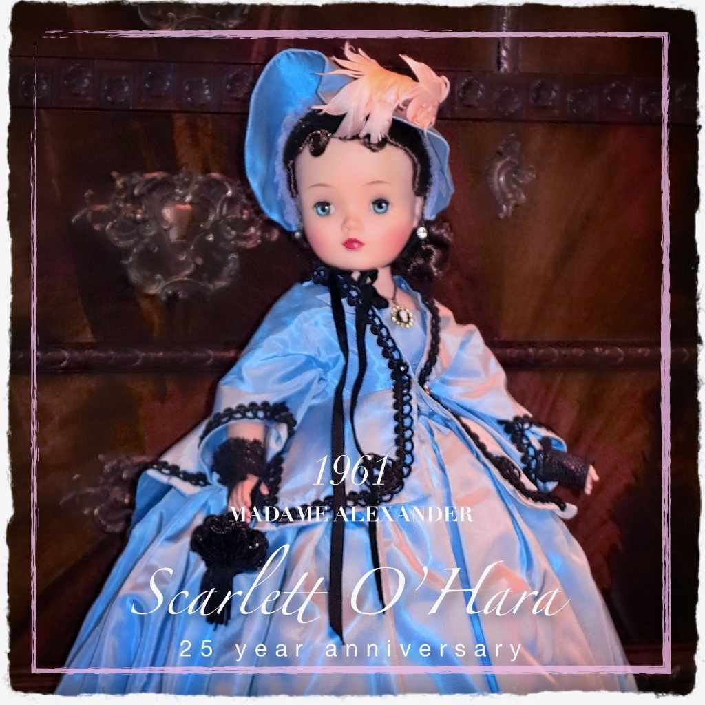 "Scarlett o'Hara, created for the 25 - year anniversary of  Gone With the Wind ,. Blue taffeta gown, trimmed with braid, with a matching coat and bonnet. Lace mitts and a velvet reticule and period jewelry complete, what the company catalog describes as ""an unforgettable doll."""