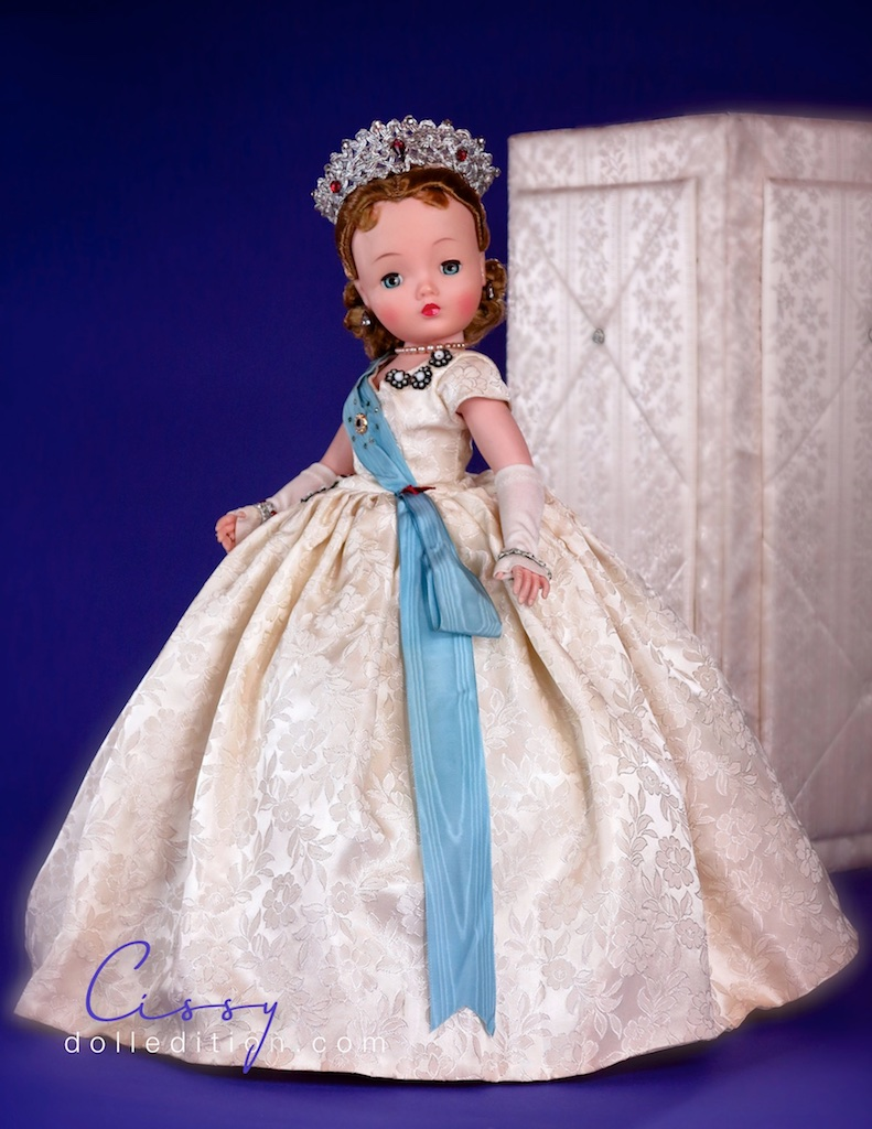 The silver medallions are, as typically seen with this doll, have tarnished. This year they also had a new crown design playing off the silver medallions. There was also introduced a slightly different hairstyle to 1959 Queen.