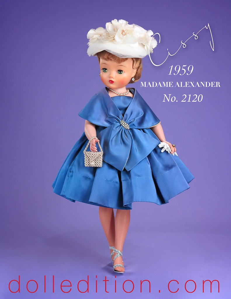 1959 Cissy No. 2120 - heavy slipper satin with a graceful matching stole accented by a rhinestone brooch. The hat is a mass of flowers and tulle... the ensemble includes a pearl purse.