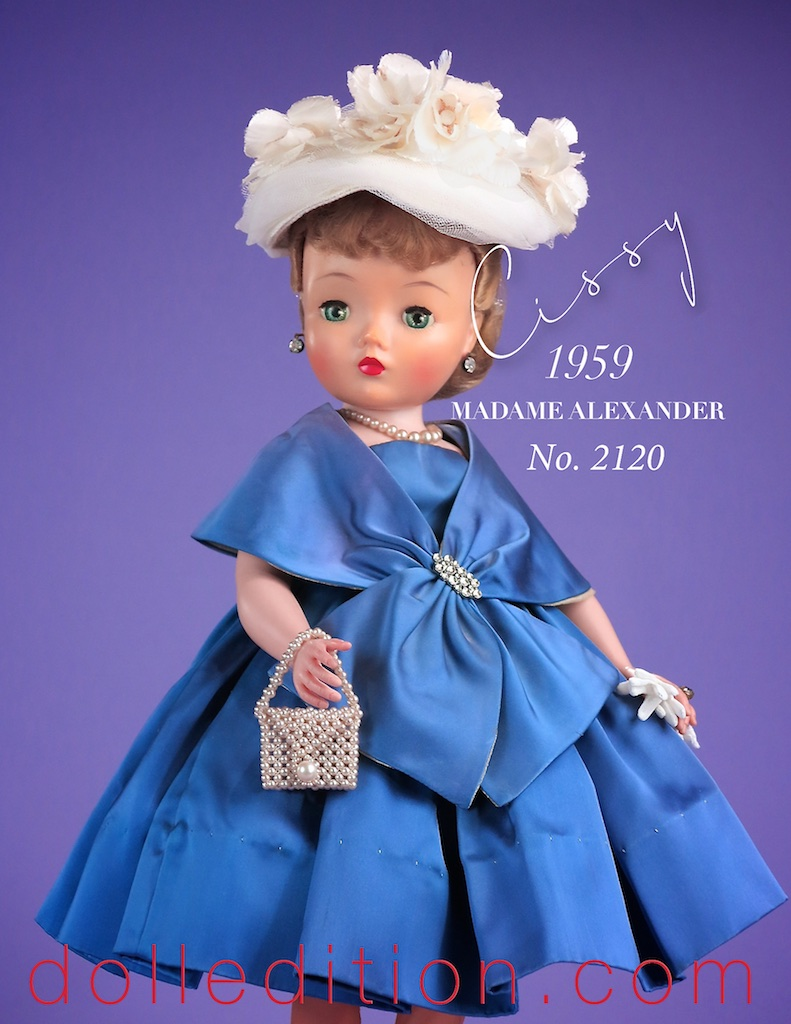 One of the more difficult Cissy's to acquire, This is a beautiful example of this 1959 No. 2120 sapphire blue slipper satin cocktail ensemble.