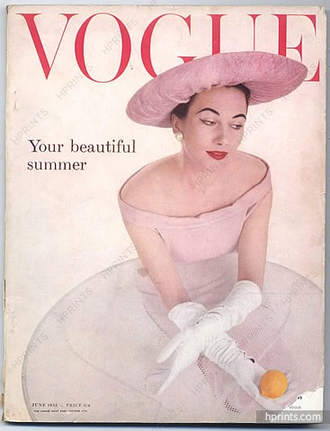 An issue of 1950s Vogue Magazine with a very large pink picture hat.