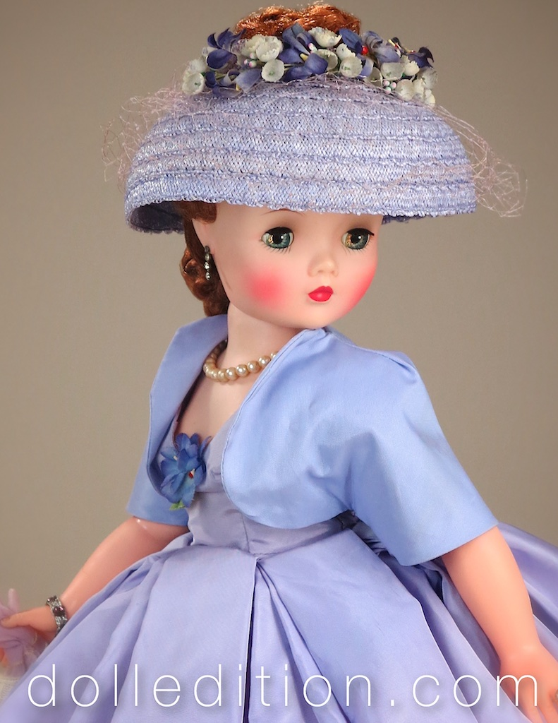 Cissy wearing her lilac straw open crown hat with netting and floral accents.Caplet, Bolero, shrugs, toppers, and fur jackets were all popular as part of the finishing touch to complete the all important fashion sillohuette of the time.