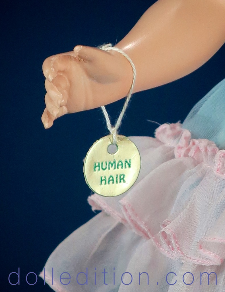 "Besides her gold Alexander cloverleaf hangtag, this doll also has a hang tag announcing her ""HUMAN HAIR"" wig."