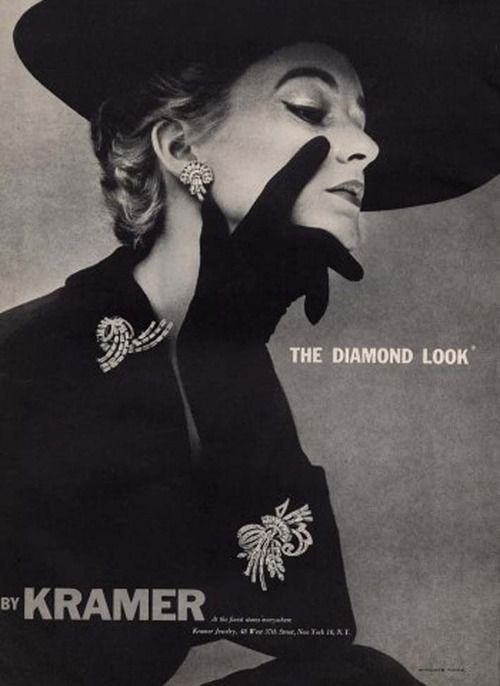 Costume jewelry in mid-century fashion was not only acceptable, it was adored in all it's color, glitter, imagination and glamor.Simultaneously, fashion houses were realizing the potential of costume jewelry to compliment their designs. Faux diamonds were particularly   appreciated, with several jewelry houses specializing in just that.
