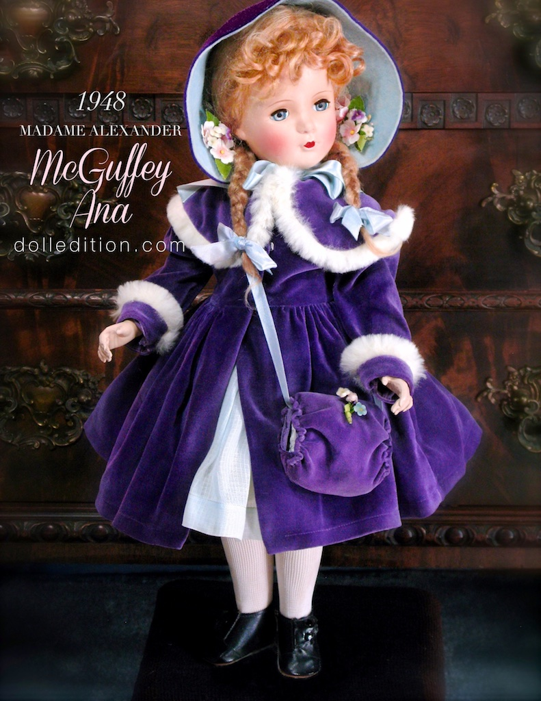 A stunning doll, McGuffey Ana is dressed in children's Victorian fashion of a purple velvet coat with fur edging, and matching muff. Baby blue lining that matches her dress and lines the coat's hood. She wears a cotton voile dress with lace trim.