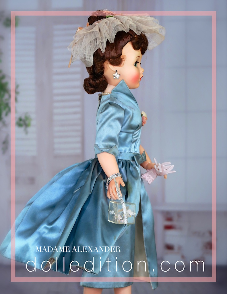 Cissy got spit curls to go with the satin sheath with overskirt. This doll also came with the flower motif rhinestone earrings.