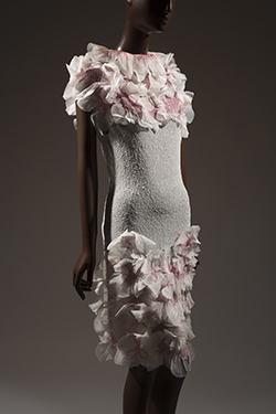 - Yoshiki Hishinuma, sheer polyester dress with rosettes, 2000, Japan, gift of Hishinuma Associates Co., Ltd.
