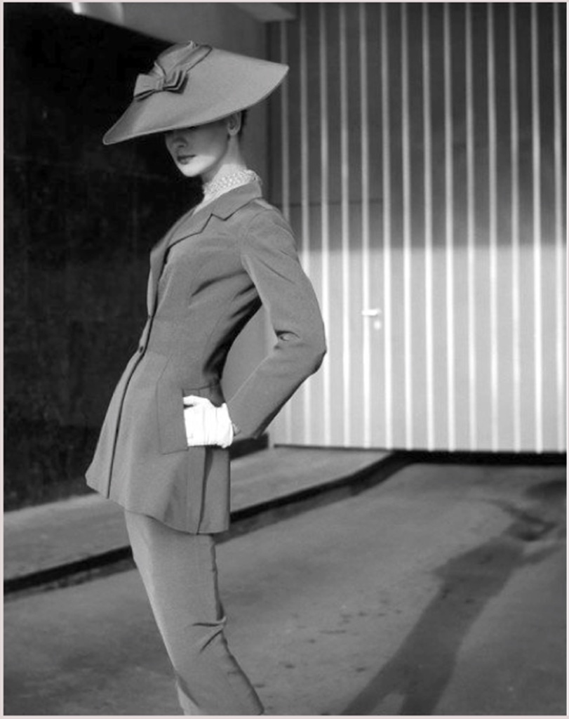 A favorite of Dior and other Parisian designers, the pagoda style hat could be quite large, and of different materials with veiling, trim or feathers.