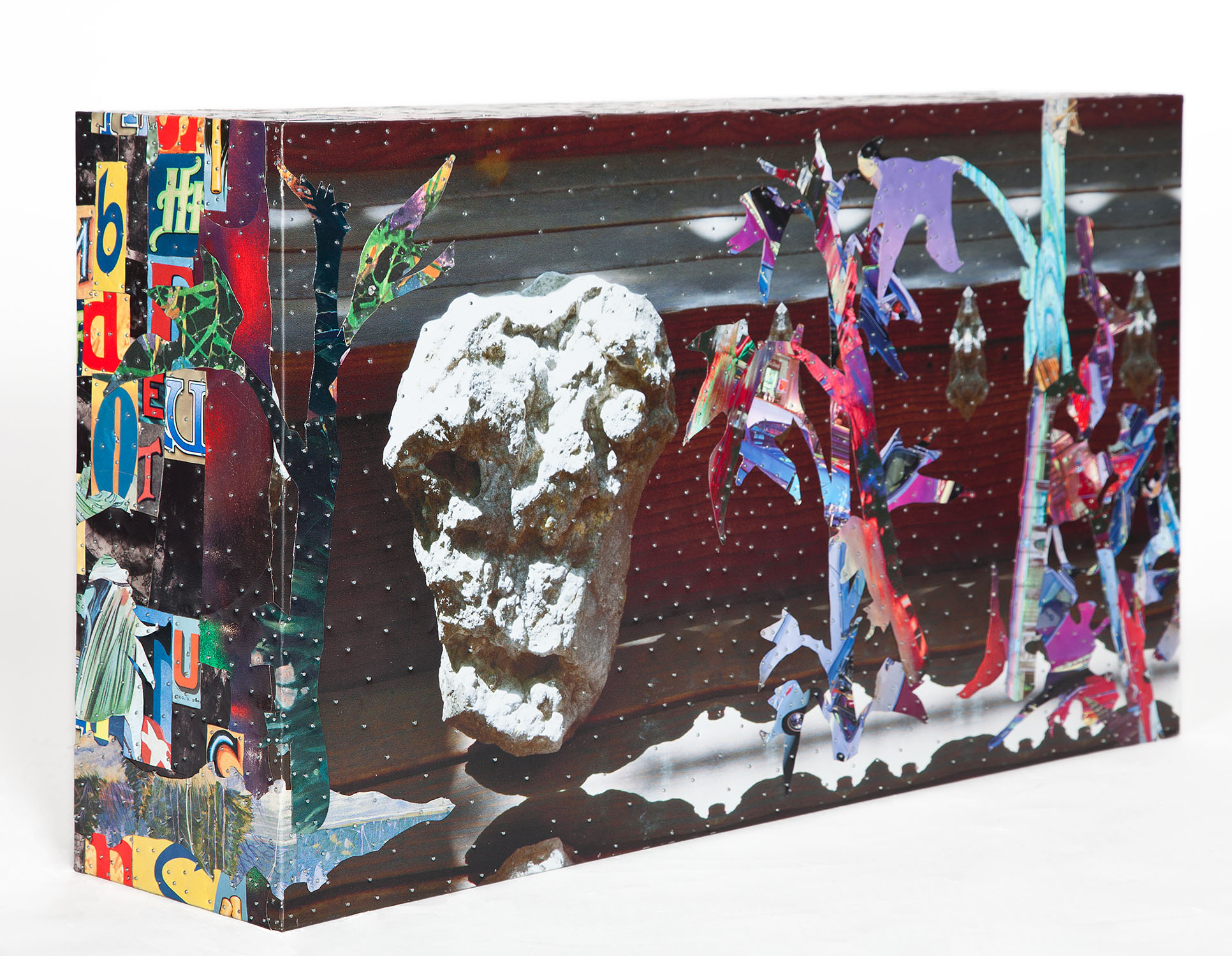 """Tony Berlant, """"Side Man,"""" 2017, found and fabricated printed tin collaged on plywood with steel brads, 15 1/2 x 27 x 6 1/2inches"""
