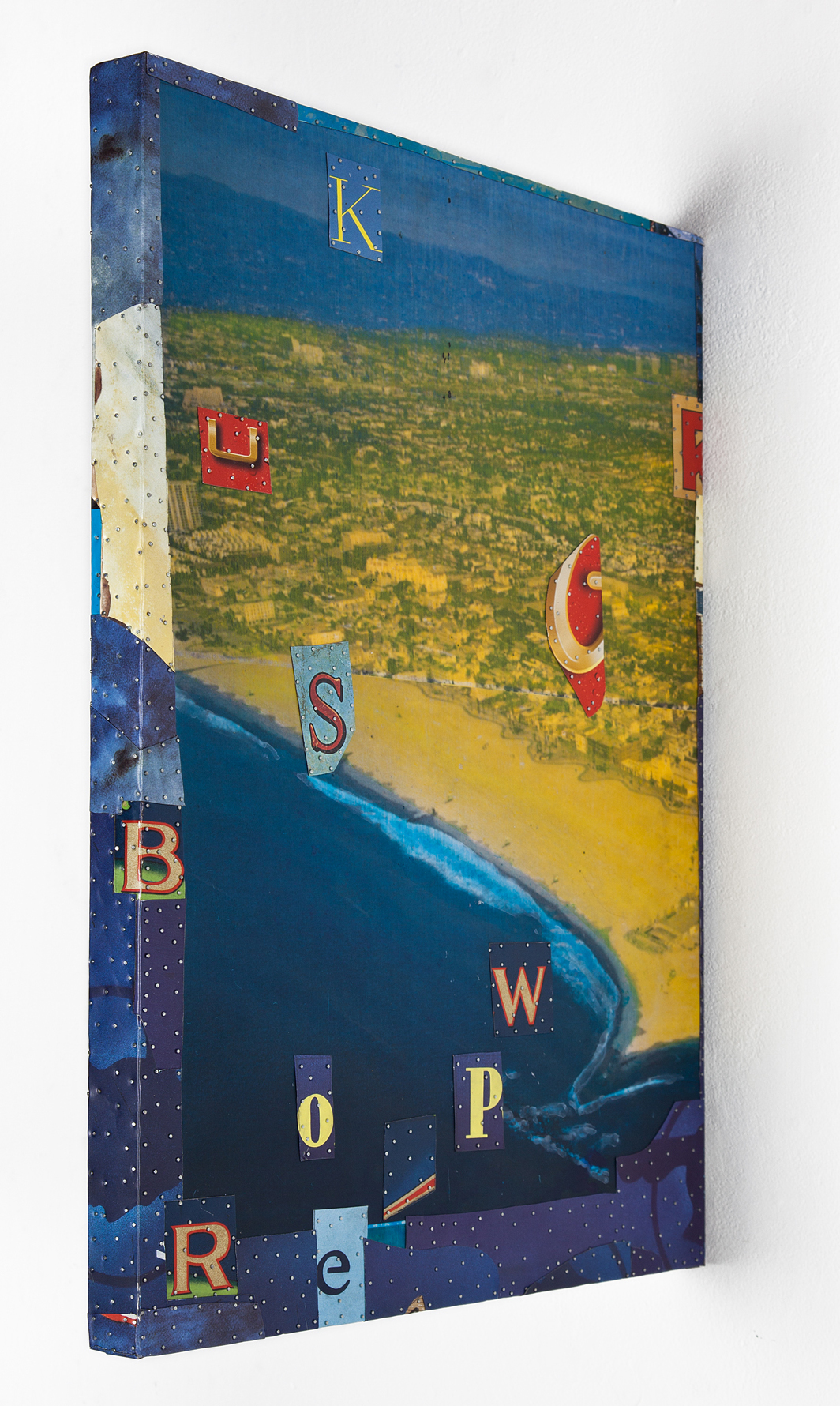 """Tony Berlant, """"The Sunny Side,"""" 2016, found and fabricated printed tin collaged on plywood with steel brads, 23 1/4 x 16 3/4 x 1 1/2 inches"""