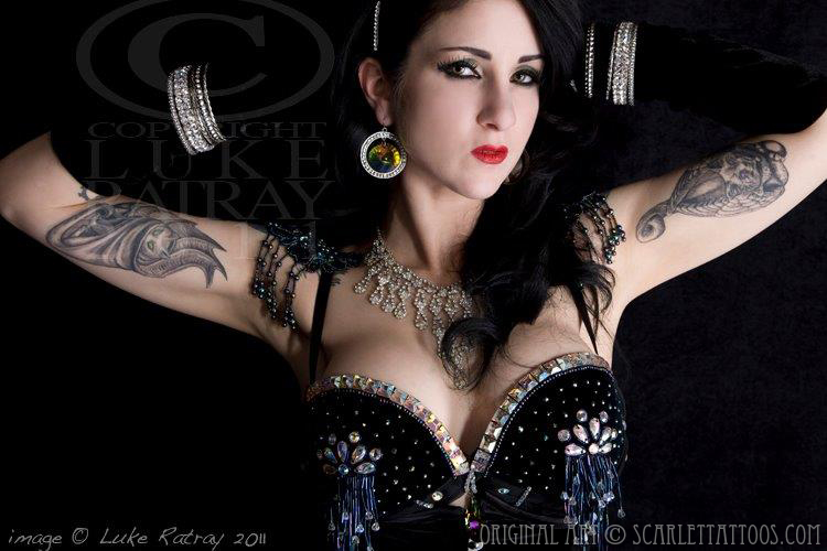 Inner bicep tattoos on Nikki Le Villain, burlesque performer.
