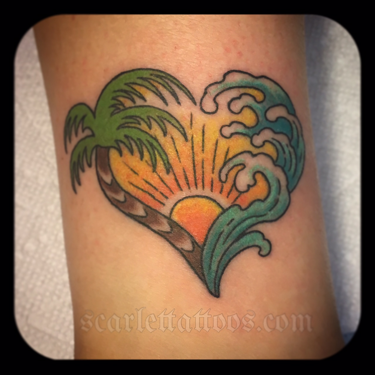 California Love tattoo with palm tree and wave