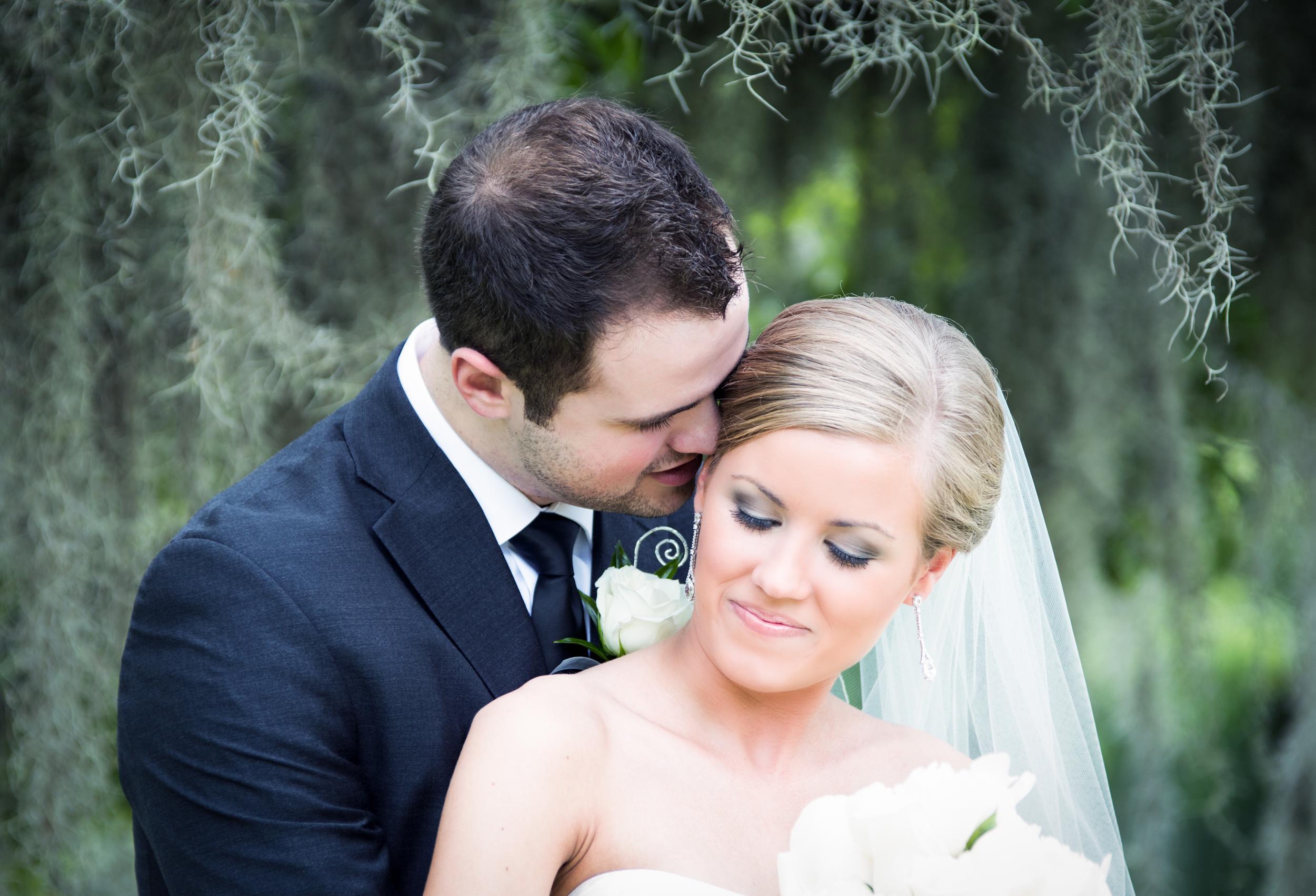 Wedding couple under moss
