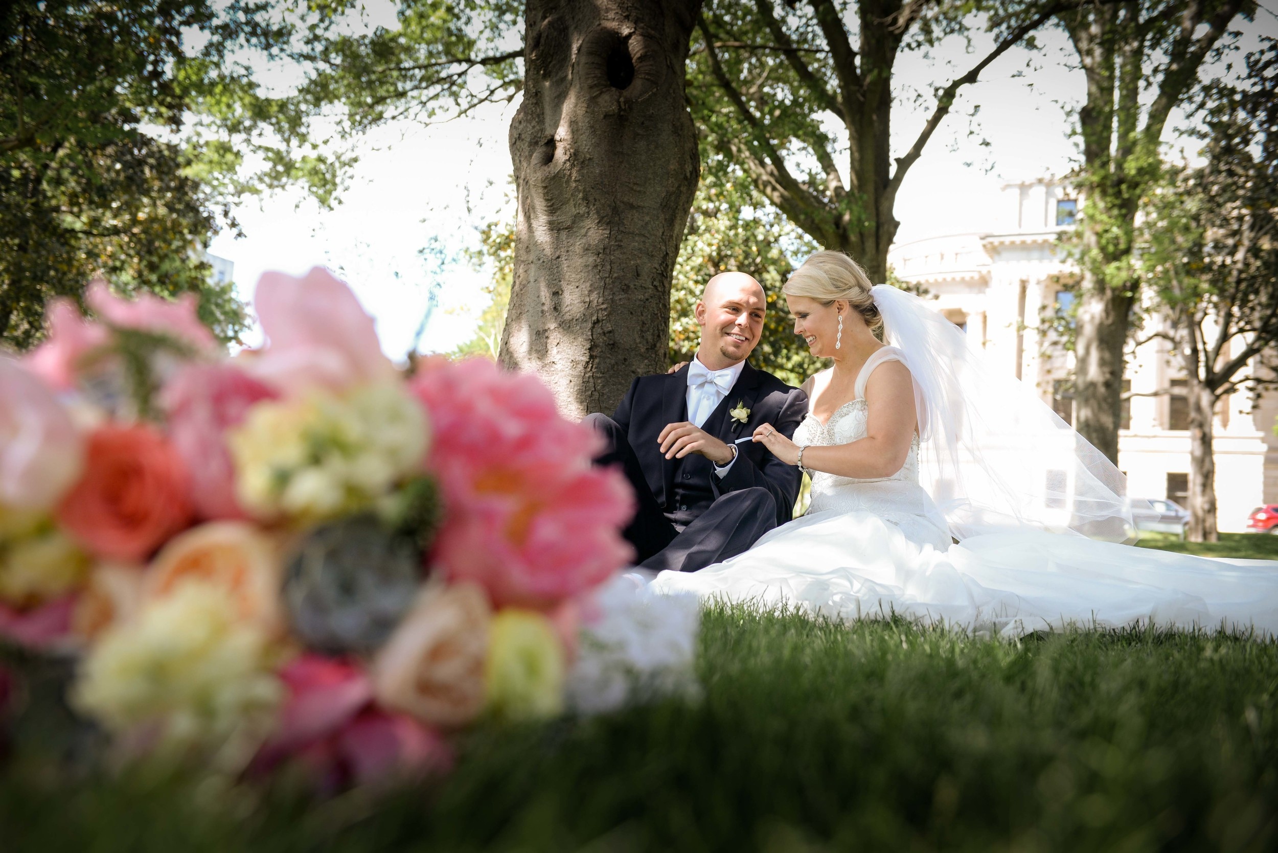 louisiana bride and groom sitting on the ground