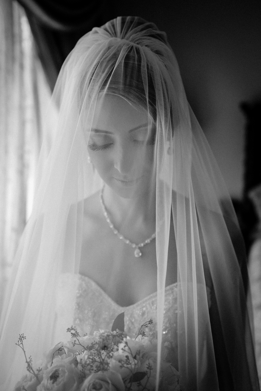 portrait of bride with veil by window