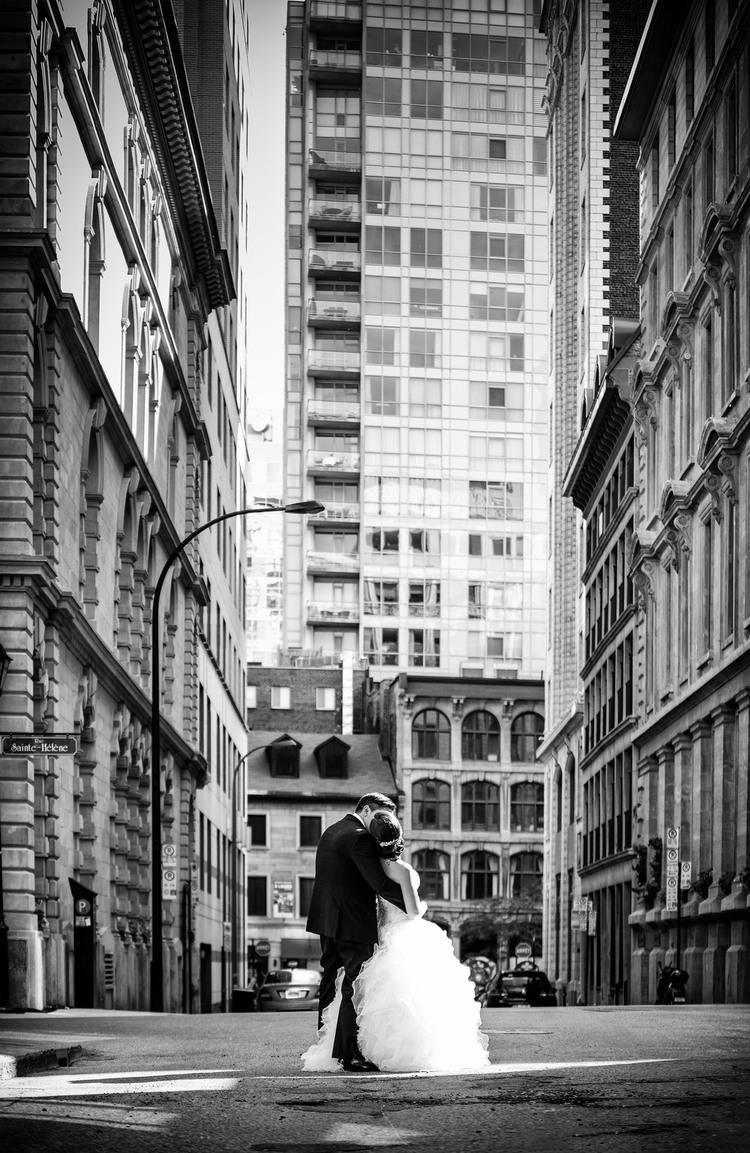 Wedding couple kissing in city