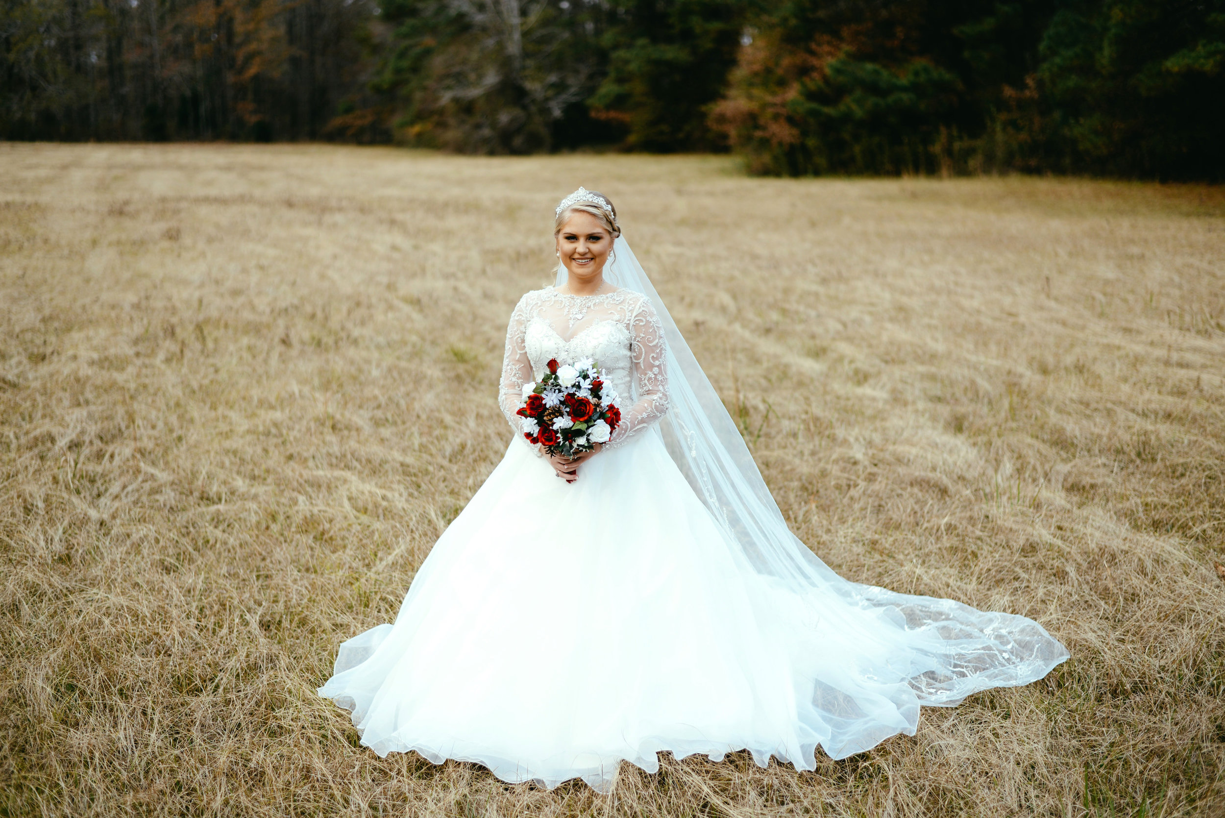 bride full gown in field
